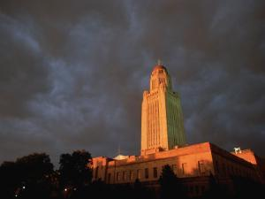 A Storm Brews Over the Nebraska State Capitol in Lincoln by Joel Sartore