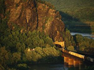 A Train Enters a Tunnel from a Railroad Bridge Over the Potomac River by Joel Sartore
