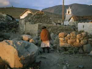 An Aymara Woman and Cat on a Path in an Atacama Desert Village by Joel Sartore