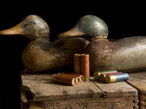Antique Duck Decoys and Shotgun Shells Sit on an Old Wooden Crate by Joel Sartore