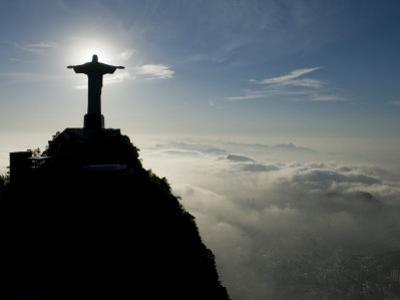 Christ the Redeemer Statue at Sunrise Above the Clouds by Joel Sartore