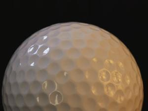 Close View of the Dimples on a Golfball by Joel Sartore
