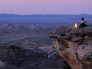 Environmental Activist at a Campfire Near Adobe Town by Joel Sartore