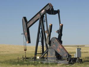 Oil Rig Pumps Oil from the Montana Ground by Joel Sartore