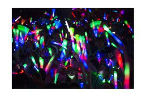 Teenagers Wave Glow Sticks at a Convention in Knoxville, Tennessee by Joel Sartore