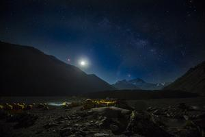 The expanse of northside Mount Everest Base camp glows with the light of the rising moon. by Joel Sartore