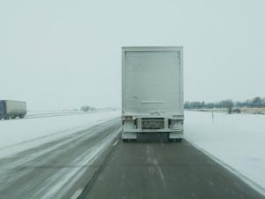 Trucks Roll Over an Icy Interstate 80 Near Lincoln, Nebraska by Joel Sartore