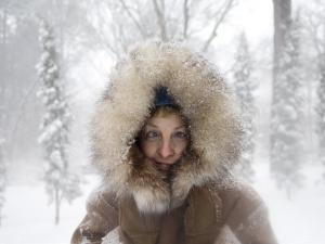 Woman Stands Outside in a Fur-Trimmed Coat after a Snowstorm by Joel Sartore