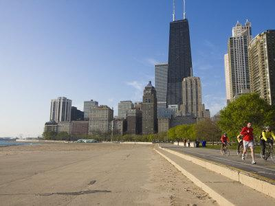 https://imgc.allpostersimages.com/img/posters/joggers-and-cyclists-on-lake-michigan-shore-oak-street-beach-chicago-illinois-usa_u-L-P7NU9S0.jpg?p=0