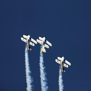 Three Aerobatic Aeroplanes Flying Straight up during an Airshow by Johan Swanepoel