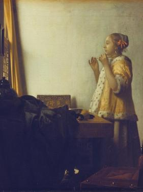 Woman with a Pearl Necklace, 1664 by Johannes Vermeer