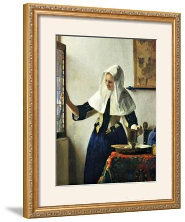 Young Dutch Woman with a Water Pitcher by Johannes Vermeer