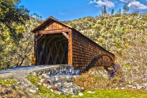 The Beautiful Bridgeport Covered Bridge over South Fork of Yuba River in Penn Valley, California by John Alves
