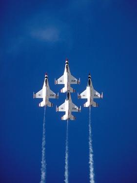 The Us Air Force Thunderbirds Climbing in a Tight Formation by John Alves