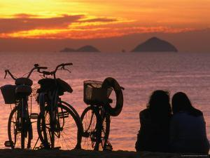 Couple at Beach at Sunrise, Nha Trang, Vietnam by John Banagan