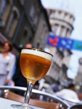 Glass of Beer at Cafe with Cathedral in Background, Boulogne-Sur-Mer, France by John Banagan