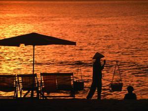 Local Carrying Baskets along Nha Trang Beach at Sunrise, Nha Trang, Khanh Hoa, Vietnam by John Banagan
