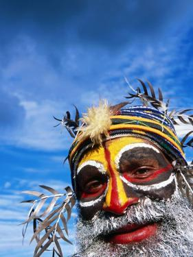 Man with Painted Face at Enga Cultural Show, Wabag, Enga, Papua New Guinea by John Banagan