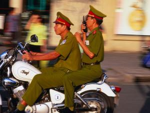 Policemen on Motorbike, Ho Chi Minh City, Vietnam by John Banagan