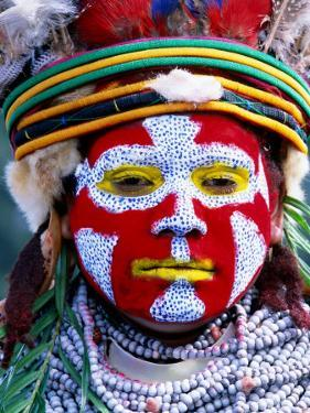 Sing Sing Group Member with Face Paint, Mt. Hagen Cultural Show, Papua New Guinea by John Banagan