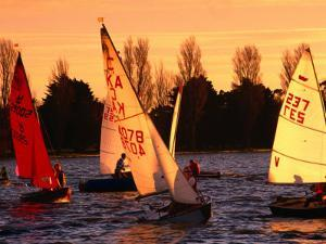 Small Yachts Sailing Around Albert Park Lake, Melbourne, Australia by John Banagan