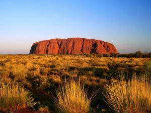 Uluru (Ayers Rock) with Desert Vegetation by John Banagan