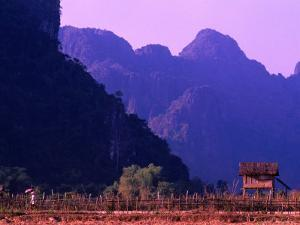 West Bank of Nam Song River, Vang Vieng, Laos by John Banagan