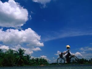 Women in Ao Dais on Bicycles, Vietnam by John Banagan