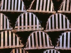 Canada, Newfoundland, Trout River, Tidy Stack of Wooden Lobster Traps by John Barger