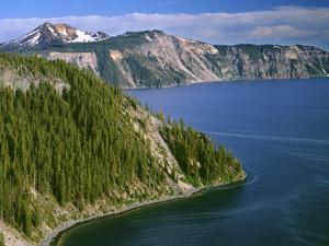 OR, Crater Lake NP. Conifer pollen accumulates on surface of Crater Lake at Cleetwood Cove by John Barger