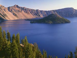 OR, Crater Lake NP. Sunrise on west rim of Crater Lake with Hillman Peak and Llao Rock by John Barger