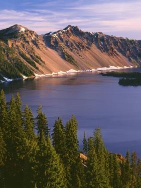 OR, Crater Lake NP. Sunrise on west rim of Crater Lake with The Watchman and Hillman Peak by John Barger