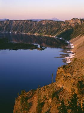 Oregon. Crater Lake NP, sunrise light on Wizard Island, view south from Merriam Point by John Barger