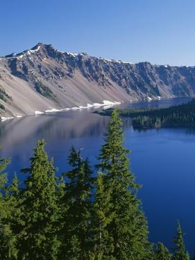 Oregon, Crater Lake NP. West rim of Crater Lake with Hillman Peakoverlooking Wizard Island. by John Barger