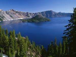 Oregon. Crater Lake NP, Wizard Island and Crater Lake with a grove of mountain hemlock by John Barger