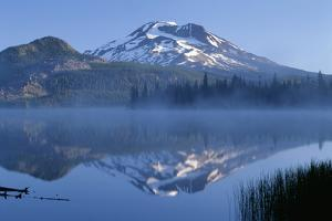 Oregon. Deschutes NF, South Sister reflects in the misty waters of Sparks Lake in early morning. by John Barger