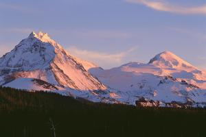 Oregon. Three Sisters Wilderness, sunset light on North and Middle Sister with autumn snow by John Barger