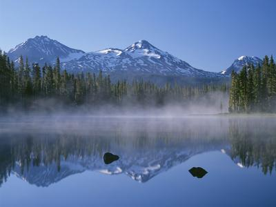 Oregon. Willamette NF, North, Middle and South Sister reflect in Scott Lake