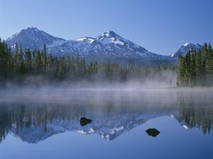 Oregon. Willamette NF, North, Middle and South Sister reflect in Scott Lake by John Barger