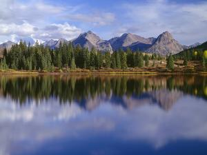 USA, Colorado, San Juan National Forest, Grenadier Range Reflects in Molas Lake in Autumn by John Barger