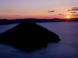 USA, Oregon. Crater Lake National Park, sunrise over Wizard Island and Crater Lake in summer. by John Barger