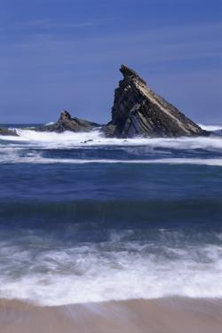 USA, Oregon, Shore Acres State Park. Incoming surf and tilted, sandstone sea stack. by John Barger