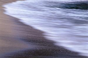 USA, Oregon, Shore Acres State Park. Waves and beach sand. by John Barger