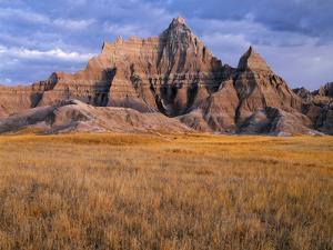 USA, South Dakota, Badlands National Park, Storm clouds over Vampire Peak by John Barger