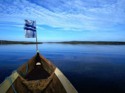 Bow of Boat with Flag Rovaniemi, Lapland, Finland
