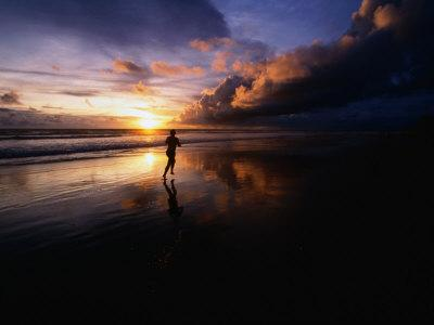 Man Jogging on Seminyak Beach at Sunset Seminyak, Bali, Indonesia
