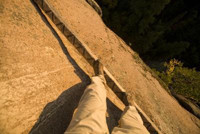 A Man Balances on a Rock Face in Stolby National Park, Krasnoyarsk, Russia