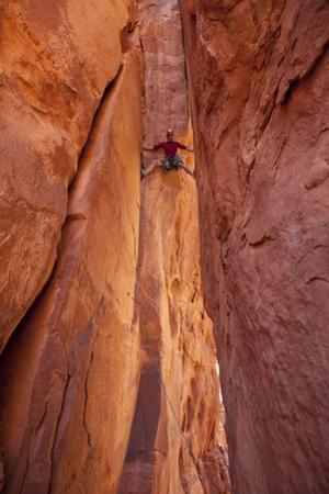 A Man Climbing a Sandstone Tower in Sedona, Arizona