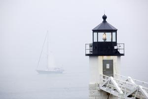 A Sailboat Passing Marshall Point Lighthouse in Port Clyde, Maine by John Burcham