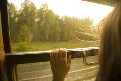A Woman Looking Through a Train Window, Siberia, Russia